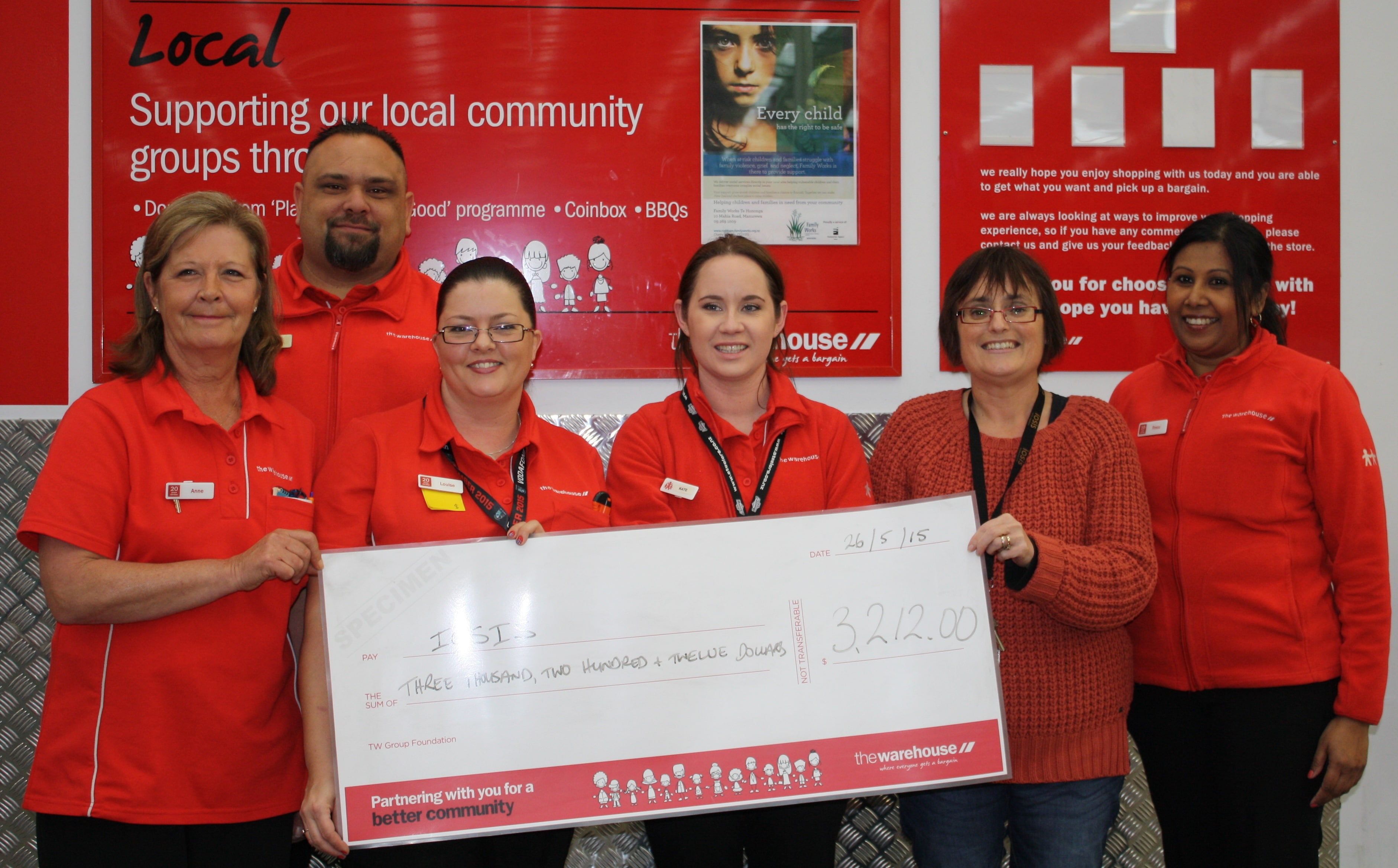 The Warehouse staff present cheque to Iosis